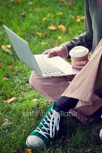 woman working with computer in the park