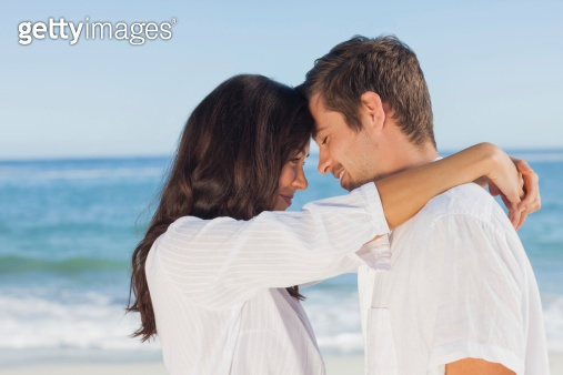 Couple embracing each other on the beach