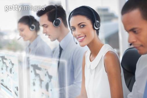 Gorgeous businesswoman using futuristic interface hologram