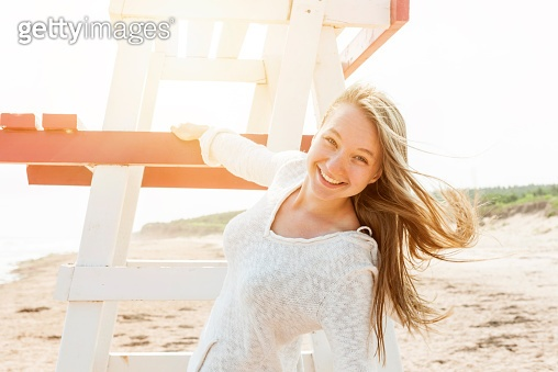Carefree young woman on beach