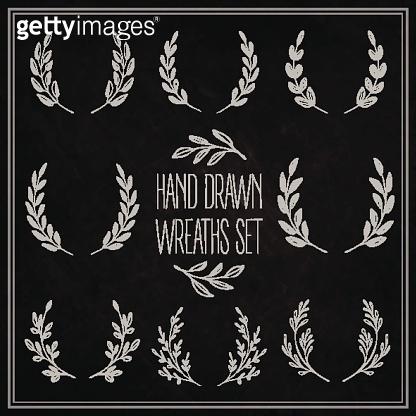 Set of decorative wreaths drawn in chalk on a blackboard