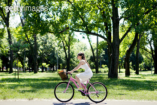 Woman with bicycle returns from shopping