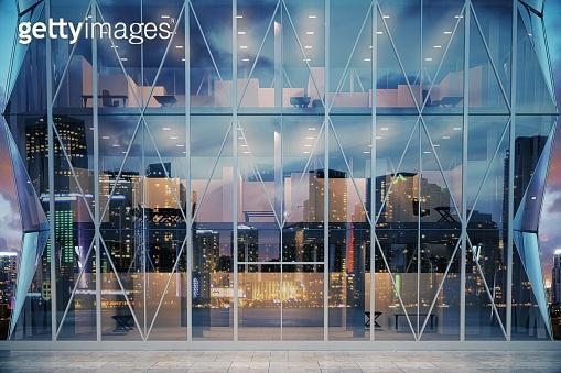 Exterior of modern glass business center at evening