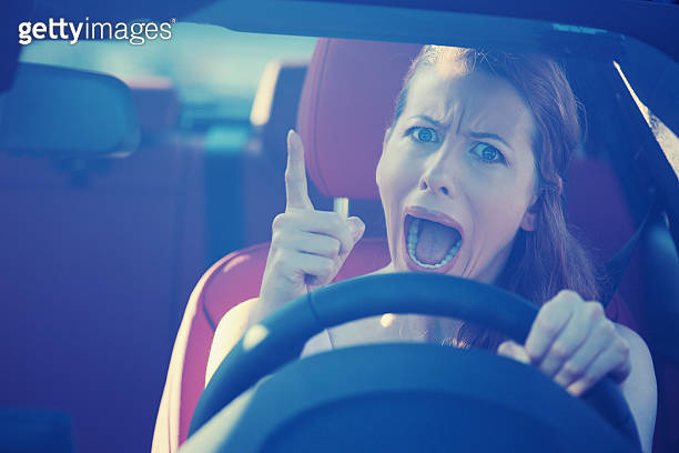 angry aggressive woman driving car