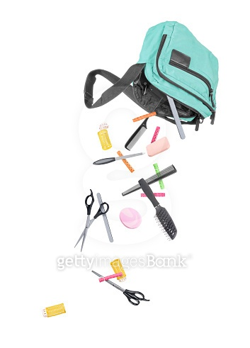 tools for beauty salon falling out of the bag