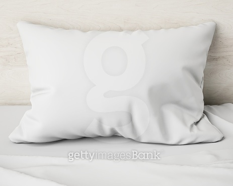 white pillow on the bed, background