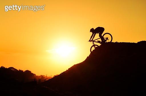 cyclist riding down hill