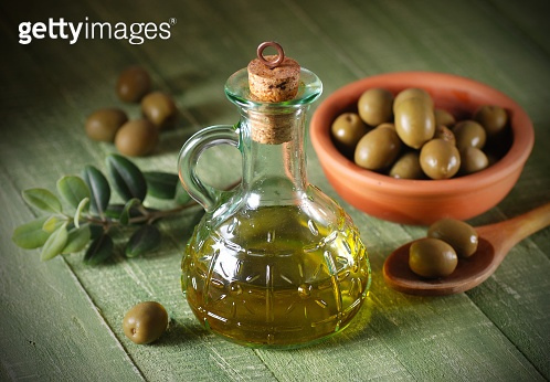 olive oil in glass bottle