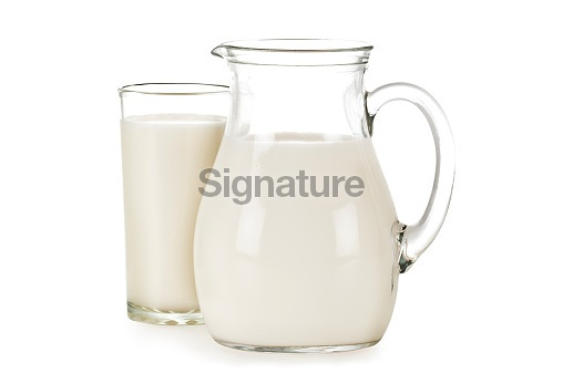 Glass and pitcher filled with milk.