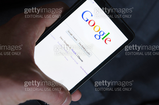 hand holding Smart phone with Google
