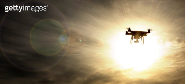 Drone U.A.V. or QuadCopter in flight, flying towards the Sun