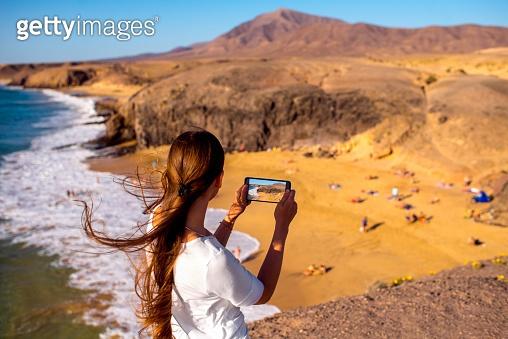 Female tourist on Papagayo beach