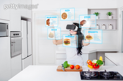Woman cooking with virtual reality glasses