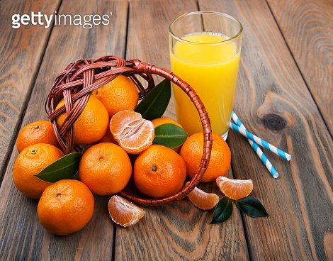Fresh citrus juice and tangerines