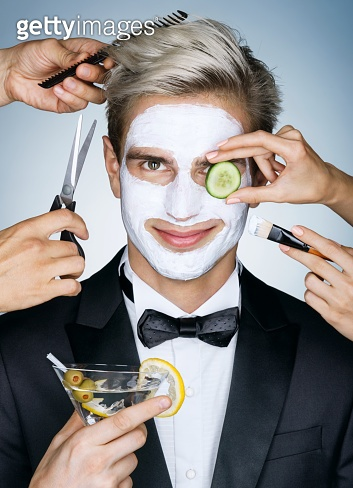 Beautiful man with moisturizing facial mask
