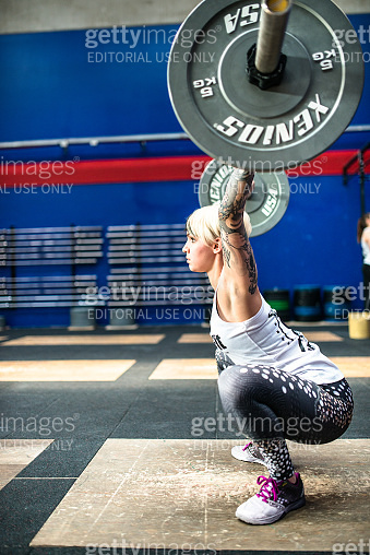 woman doing a strong training gym weightlifting