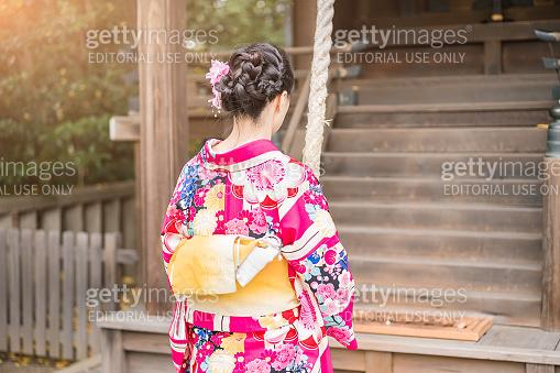 Japanese woman praying at a temple