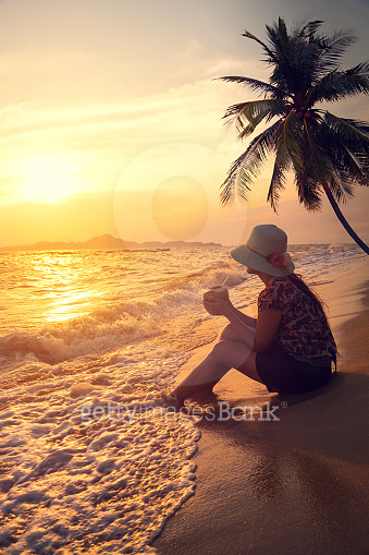 woman relax on beach at sunset