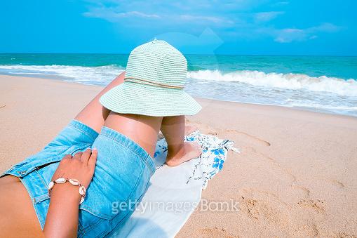 women lying on beach