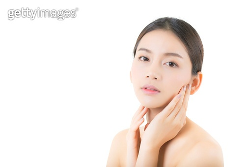 Beautiful girl with makeup, woman and skin care cosmetics concept / attractive asian girl smilling on face isolated on white background.