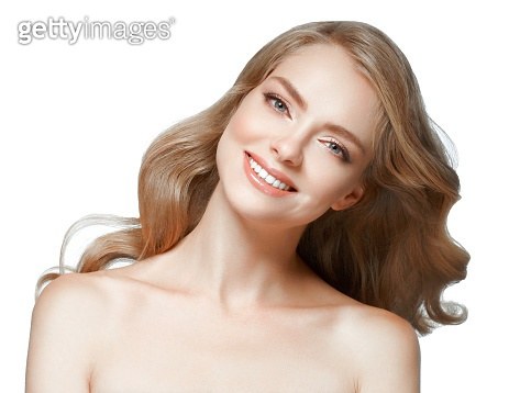 Woman beauty. Blond woman with healthy skin. Isolated on white.