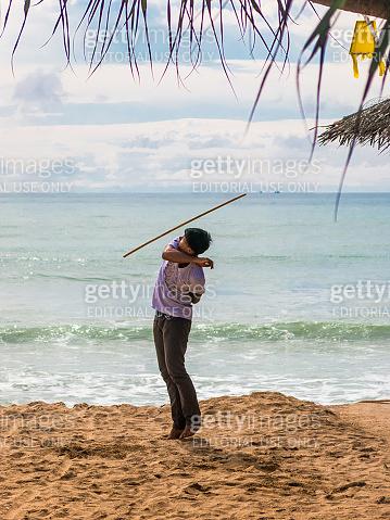 Man Baton Twirl Throw Practise Beach Koh Lanta Thailand