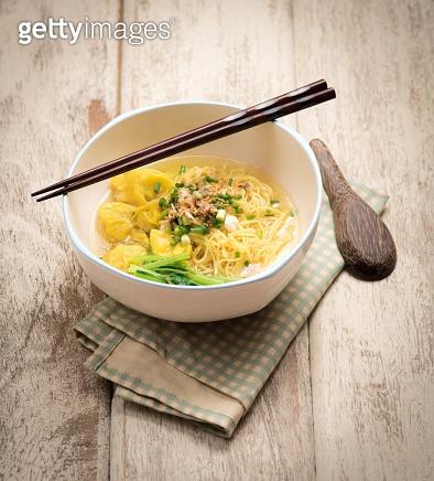 Egg noodle soup on tabel wood