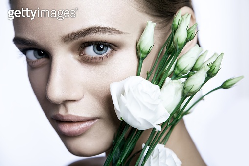 Calm Beauty Fashion Model Woman face with white rose.