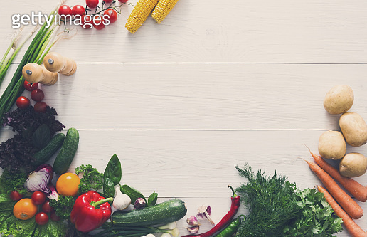 Fresh vegetables border on white wood background with copy space