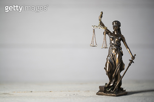Law and Justice concept. Mallet of the judge,  Gray background, place for typography. Courtroom theme.