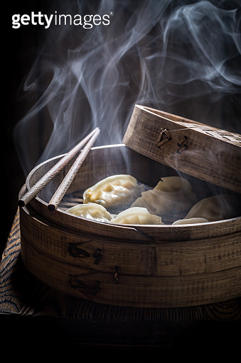 Hot and tasty chinese dumplings in bamboo steamer