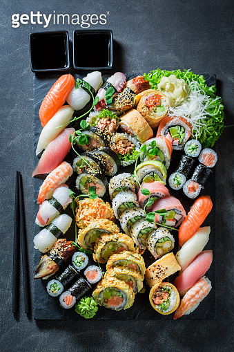 Tasty sushi mix made of fresh vegetables and seafood