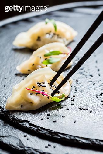 Closeup of homemade gyoza dumplings on black rock