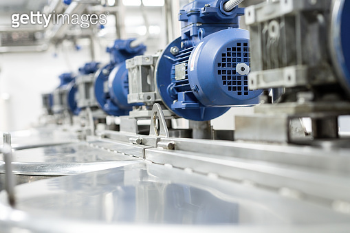Electric motors on steel tanks for mixing liquids, modern production of alcoholic beverages