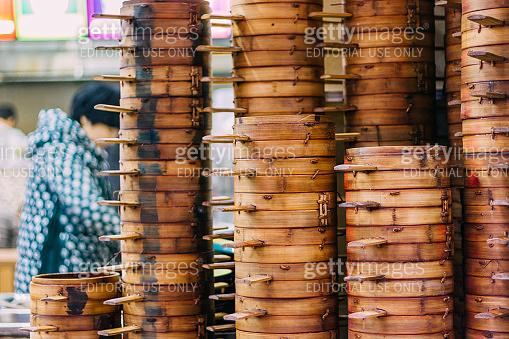 column of  steamer baskets of Dim Sum