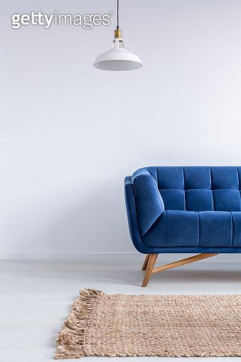 Home interior with blue sofa