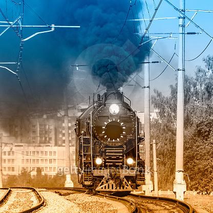 Steam train moves toward.