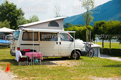TRAUNSEE, AUSTRIA - 20.06.2017: Trailers camping on Traunsee lake shore in Austrian Alps