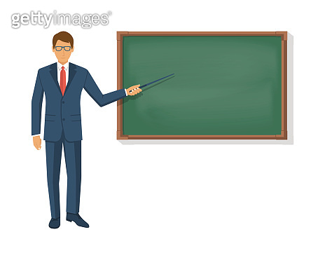 Teacher standing in front of blank school blackboard