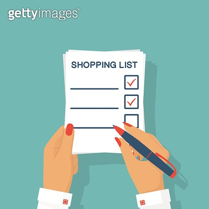 Woman hands shopping list