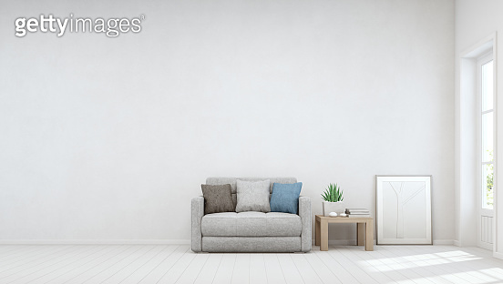 Indoor plant on wooden coffee table and small sofa with empty white concrete wall background, Relaxing area near door in bright living room of modern scandinavian house