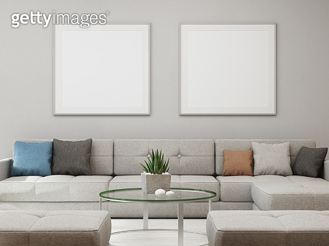 White empty frame mock up on concrete wall background, Sofa and table with blank poster in bright living room of modern house
