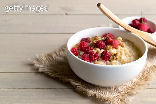 Breakfast with oatmeal and fresh raspberries.