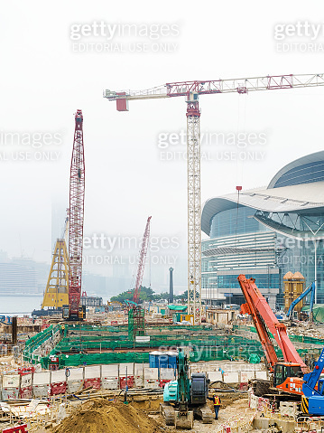 Construction site with workers in center HK