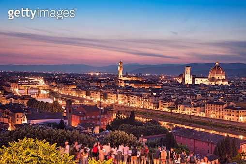 A fabulous panoramic view of Florence from Michelangelo Square in the evening lights. It is a pilgrimage of tourists and romantics. Duomo Cathedral. Italy, Tuscany