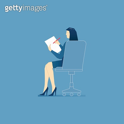 Business woman sits in an office chair and writes