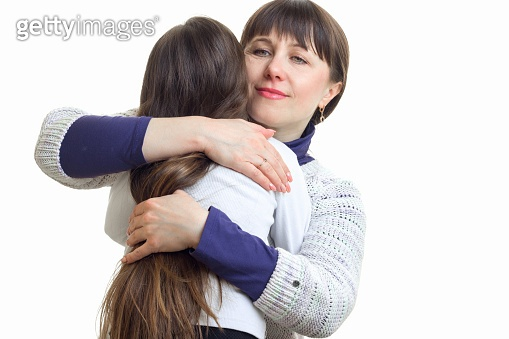 mom tightly embraces her daughter
