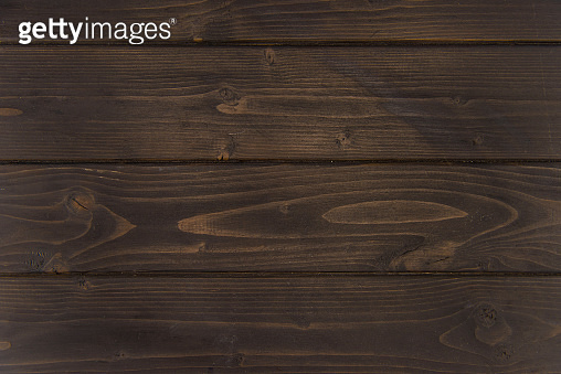 Close-up view of dark brown wooden horizontal planks, wood background
