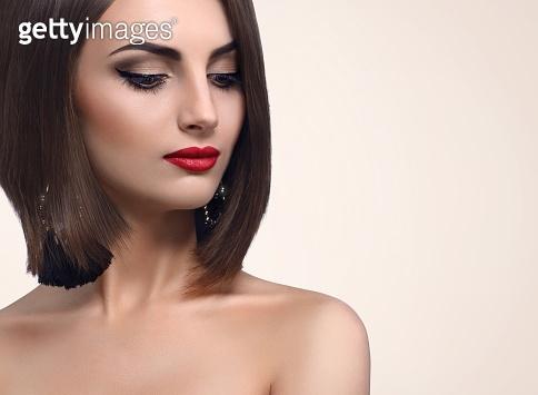 Beautiful elegant young woman posing in studio