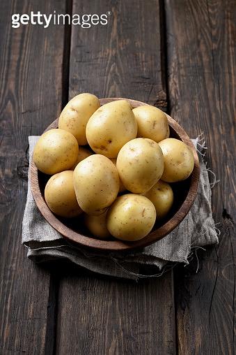 Raw potatoes in bowl